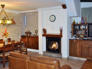Gli Artigiani dei f.lli M.& S. Cordi snc Living roomFireplaces & accessories Wood