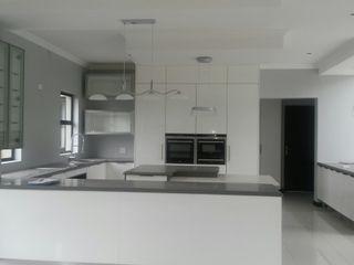 Première Interior Designs KitchenCabinets & shelves White