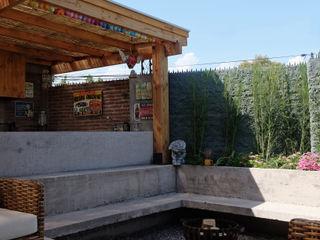 ESTUDIO BASE ARQUITECTOS Rustic style garden