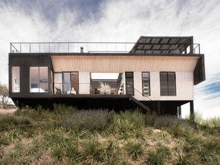 B+V Arquitectos Casas modernas Madera Acabado en madera