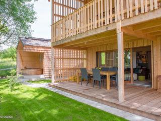 w. raum Architektur + Innenarchitektur بلكونة أو شرفة