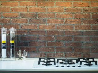 B&B Rivestimenti Naturali Industrial style kitchen Bricks