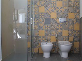 Stanza da bagno in cementine decorate Romano pavimenti Bagno eclettico