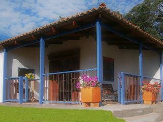 casa cafetera Construexpress Casas de estilo rural Concreto Blanco