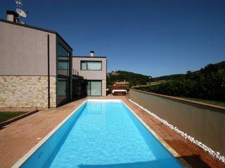 Villa unifamiliare con piscina a Foligno (PG) Fabricamus - Architettura e Ingegneria Case moderne