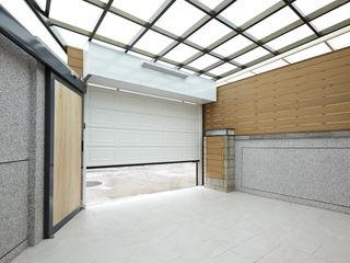 映荷空間設計 Garajes de estilo moderno