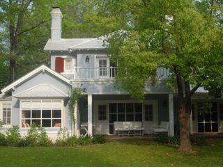 Casa en Argentino Golf Club Rocha & Figueroa Bunge arquitectos Casas clásicas