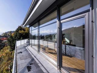 KitzlingerHaus GmbH & Co. KG Modern Houses Engineered Wood Grey