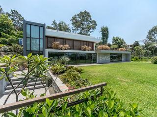 FACHADA FRONTAL DMS Arquitectas Casas modernas