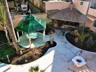 Casa con piscina. Imperatore Architetti Giardino classico