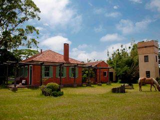 CABRAL Arquitetos Casas de estilo rural