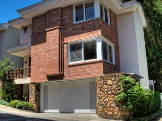 CABRAL Arquitetos Casas de estilo moderno Ladrillos