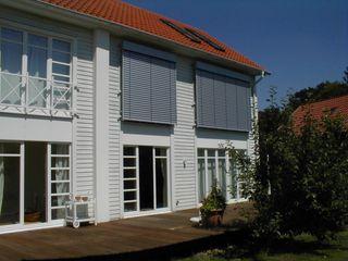Mester Fenster-Rollladen-Markisen Будинки