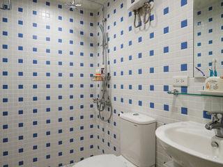弘悅國際室內裝修有限公司 Baños de estilo rural Azulejos Azul