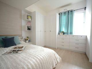 搭配設計師淺色的木紋配色與橡木色超耐磨木地板,營造出清新舒適的主臥空間。 大觀創境空間設計事務所 اتاق خواب