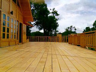 Sukjai Logcabin Partnership Negozi & Locali commerciali in stile classico Legno massello Effetto legno
