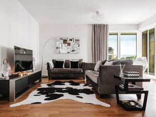 Boutique Hotel Apartment Katie Malik Interiors Modern living room Black