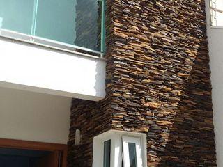 Rebello Pedras Decorativas Casas de estilo moderno Piedra Marrón