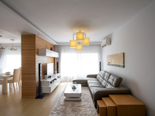 Dr. Allam Apartment CUBEArchitects ミニマルデザインの リビング 木 白色