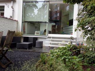 Aménagement d'un jardin de ville avec une cabane sur mesure Urban Garden Designer JardinAbris de jardin & serres Laine