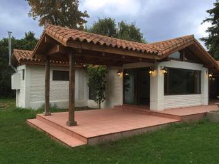 ARCOP Arquitectura & Construcción 컨트리스타일 주택