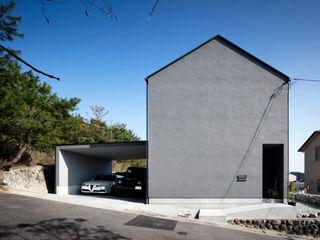 川添純一郎建築設計事務所 Casas unifamiliares Gris