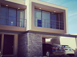 Xome Arquitectos Modern home Stone Beige