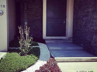 Xome Arquitectos Modern home Stone Grey