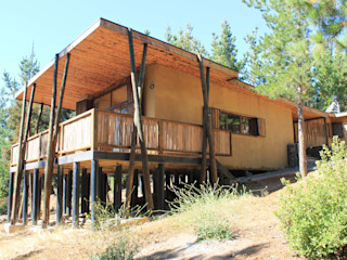 KIMCHE ARQUITECTOS Rustic style house Beige