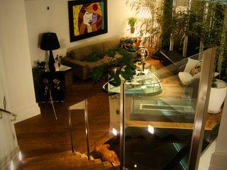Residencia Alves STUDIO AGUIAR E DINIS Livings de estilo moderno