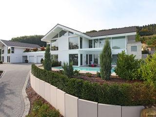 Kundenhaus Gräfenstein - Zwei Bungalows in Ostwestfalen DAVINCI HAUS GmbH & Co. KG Moderne Häuser