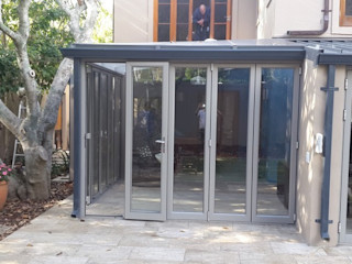 Built in Wooden Sliding Doors, Slab Cast And Tiled Patio, Aluminium And Glass Conservatory, Exterior House Painted, Aggregate Driveway Layed. CPT Painters / Painting Contractors in Cape Town
