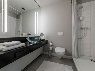 Ohlde Interior Design Ванна кімната Сірий