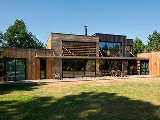 EC-Bois   Maison Laviron   Jouars-Pontchartrain EC-BOIS Chalets & maisons en bois Bois d'ingénierie Effet bois