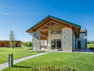 Woodbau Srl Дерев'яні будинки Камінь