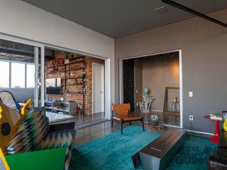 Nautilo Arquitetura & Gerenciamento Salon industriel Gris