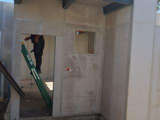 SISTEMAS MODULARES DE CONSTRUCCION homify Casas prefabricadas Hormigón Acabado en madera