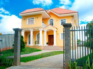 Grupo DH arquitetura Single family home Stone Yellow