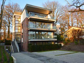 Modernes Mehrfamilienwohnhaus in Hamburg Architekt Witte Moderne Häuser Ziegel Lila/Violett
