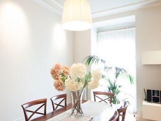 Reforma integral de apartamento modernista en Barcelona ETNA STUDIO Comedores de estilo moderno Arenisca Blanco