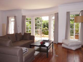 El efecto de un poquito de carño Lúmina Home Staging SalonesSofás y sillones Lino Marrón