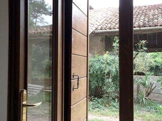 Casa in cascina atelier architettura Porte d'ingresso