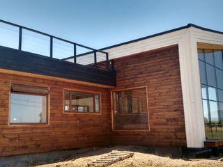 KIMCHE ARQUITECTOS Casas de madera Madera