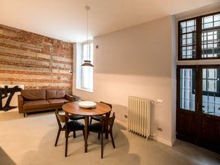PADIGLIONE B Modern living room Bricks Beige