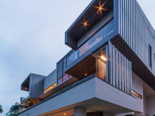 MJ Kanny Architect Casas de estilo moderno