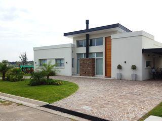 MONARQ ESTUDIO Single family home White