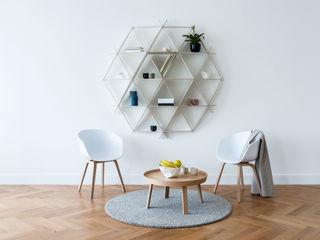 homify WohnzimmerHocker und Stühle