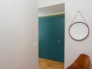 CASA M+P. FIRENZE OKS ARCHITETTI Ingresso, Corridoio & Scale in stile moderno
