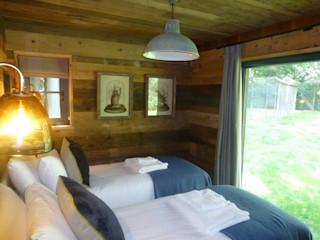 Tiger Lodge Building With Frames Colonial style bedroom Wood