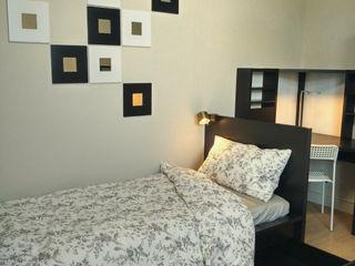 黑白色調雙人套房傢俱配置 以恩室內裝修設計工程有限公司 臥室